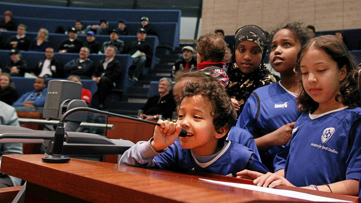 Six-year-old Ibrahim Aden, player with Ifyes soccer club in Etobicoke, takes his turn to talk while attending, along with his team, a public meeting a Toronto City Hall to discuss the impact of new user fees the city is imposing for city owned sport fields.