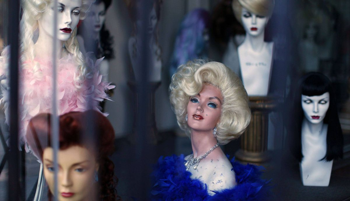 A wig store shows off its products in a store front window on Hollywood Boulevard in Hollywood, California February 22, 2012.