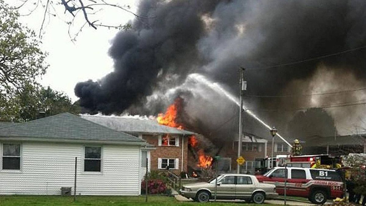 In this image made from video and provided by WVEC TV, smoke billows near an apartment complex where a Navy jet crashed in Virginia Beach, Va., Friday, March 6, 2012.