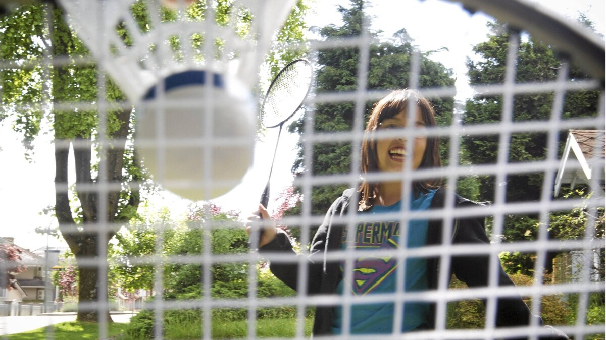 Allison Wong plays badminton at her home in Vancouver.