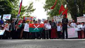People from Myanmar living in Malaysia raise banners and placards during a protest near the Myanmar embassy in Kuala Lumpur on October 11, 2011.