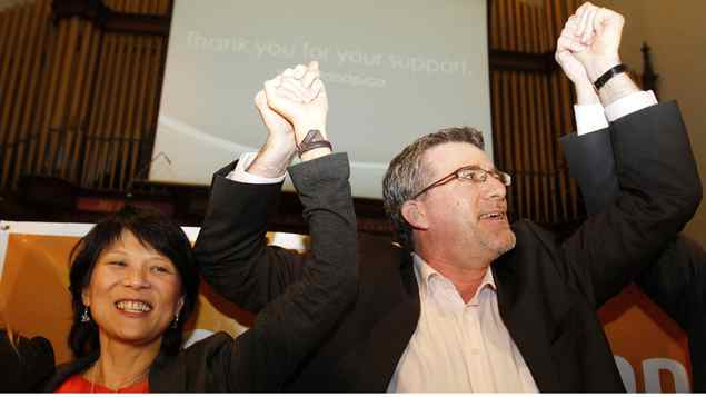 NDP MP Olivia Chow celebrates with law professor Craig Scott, the party's new candidate in a by-election in the old Toronto-Danforth of Ms. Chow's now-deceased husband, Jack Layton.