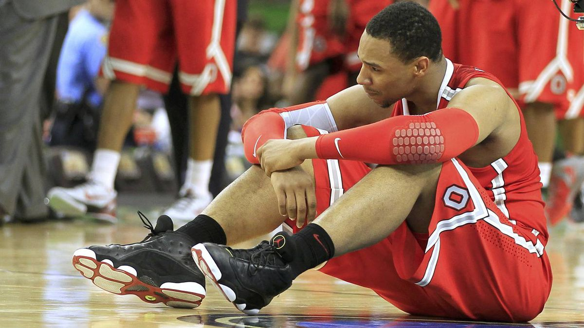 Ohio State Buckeyes forward Jared Sullinger sits on the court after the Buckeyes were defeated by the Kansas Jayhawks in the men's NCAA Final Four semi-final college basketball game in New Orleans, Louisiana, March 31, 2012. REUTERS/Lucy Nicholson