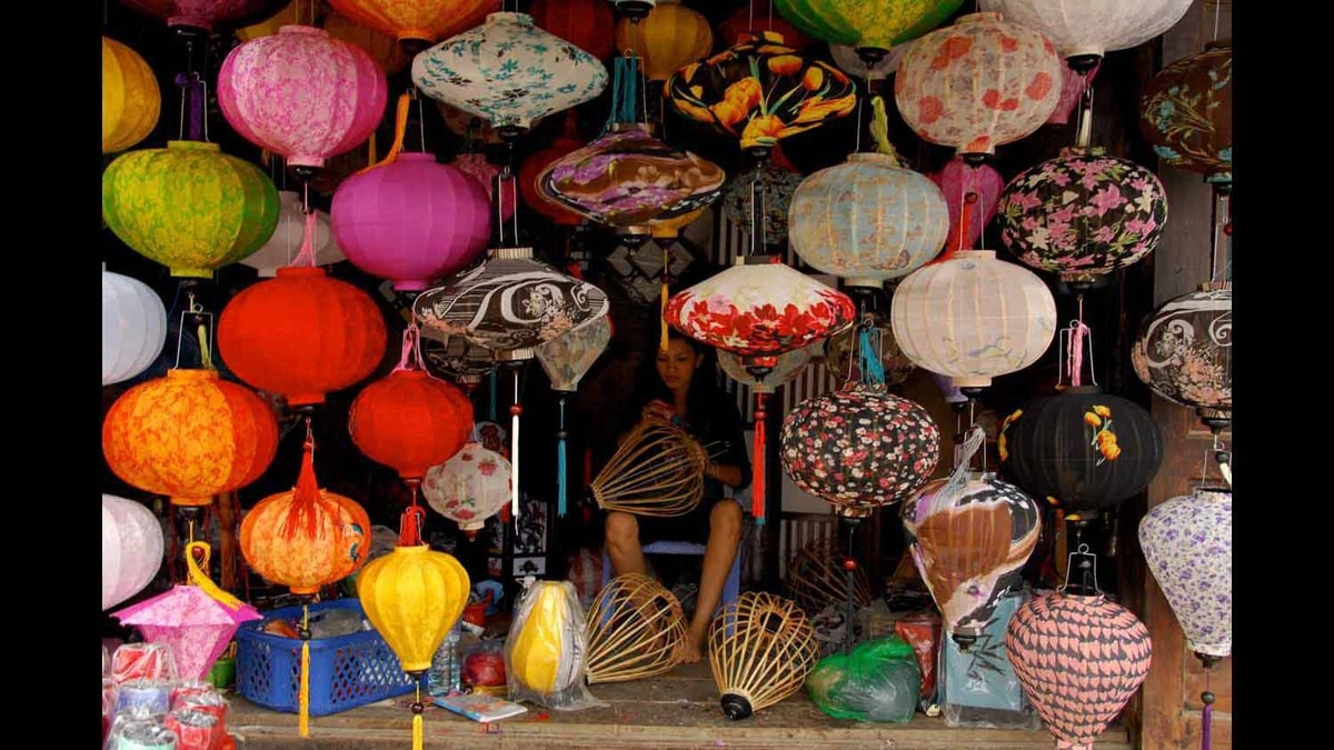 In the ancient Vietnamese town of Hoi An, a woman continues the multi-generational tradition of hand crafting boiterous paper lanterns (Jan, 2012)