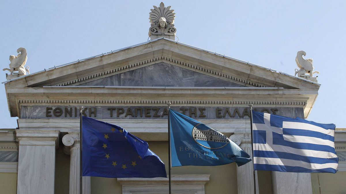 Flags from right, Greek, National Bank of Greece and the European Union flags wave outside the headquarters of the National Bank of Greece in Athens.