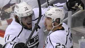 Los Angeles Kings right wing Dustin Brown (23) celebrates his 3rd period goal against the Phoenix Coyotes with teammate Anze Kopitar (11) during Game 1 of the NHL Western Conference hockey finals in Glendale, Arizona, May 13, 2012. REUTERS/Todd Korol