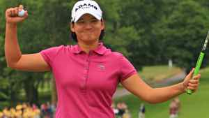 Yani Tseng of Taiwan celebrates her ten stroke victory on the 18th hole during the final round of the Wegmans LPGA Championship at Locust Hill Country Club on June 26, 2011 in Pittsford, New York. (Photo by Hunter Martin/Getty Images)