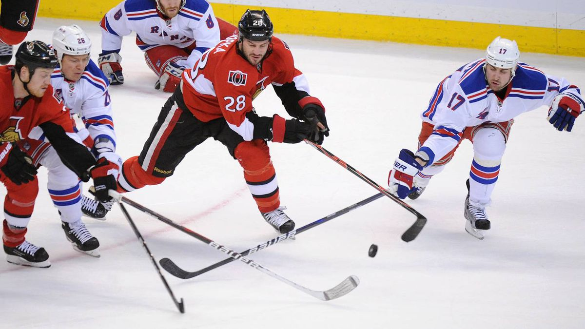 Ottawa Senators' Chris Neil, left, and Zenon Konopka, middle, fight to get to the puck against New York Rangers' Ruslan Fedotenko, second from left, and Brandon Dubinsky, right, during the first period of game six of first round NHL Stanley Cup playoff hockey action at the Scotiabank Place in Ottawa on Monday, April 23, 2012. THE CANADIAN PRESS/Sean Kilpatrick