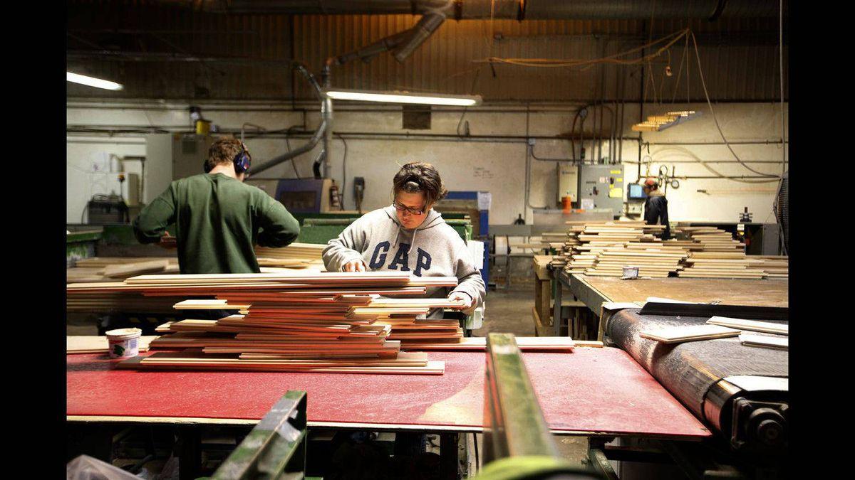 Employees at South Bruce Flooring in Mildmay, Ont., prepare hardwood flooring.