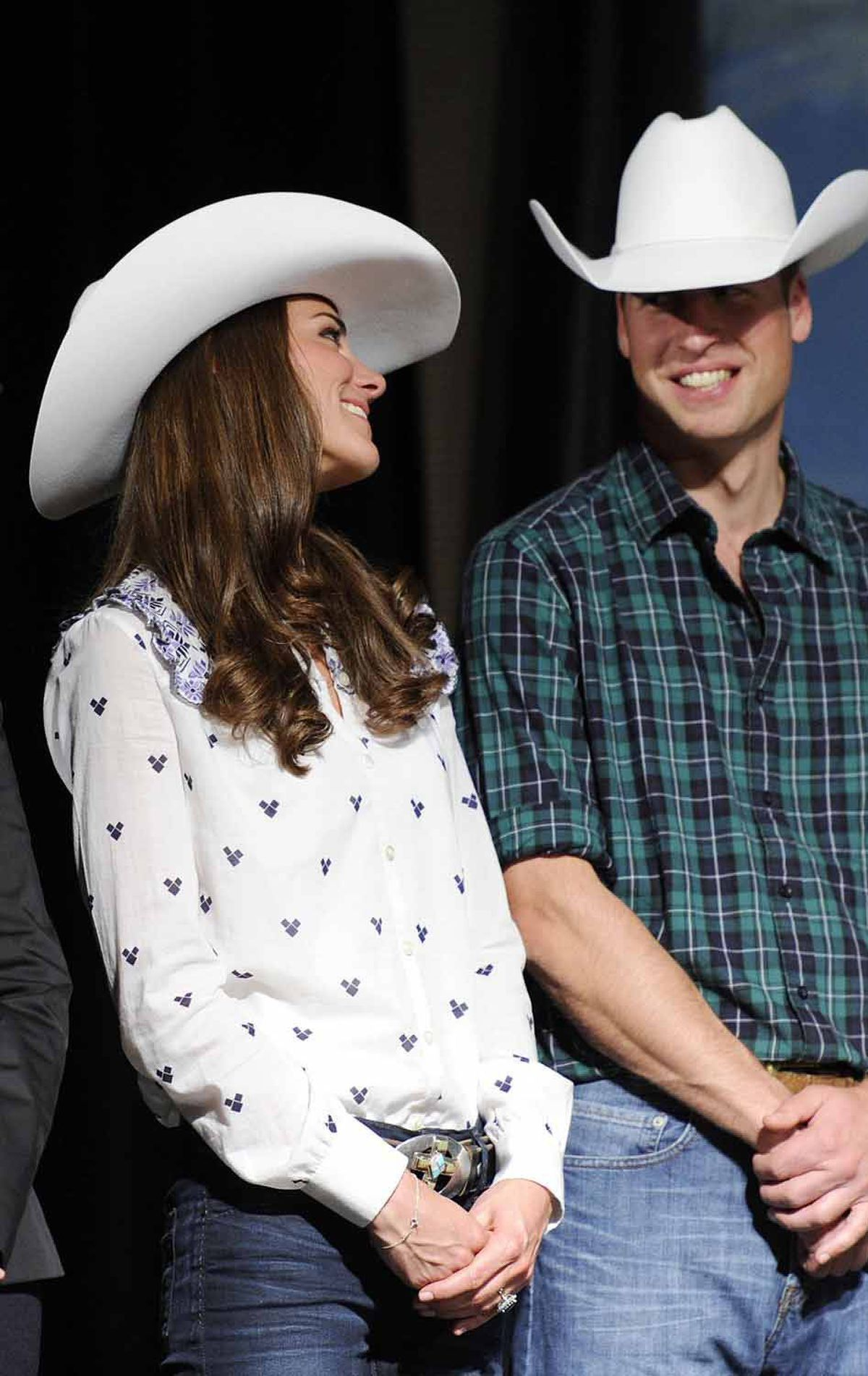 Later in the day she changes into a more casual outfit, featuring the 10-gallon hat presented to her on arrival and an Alice Temperley top.