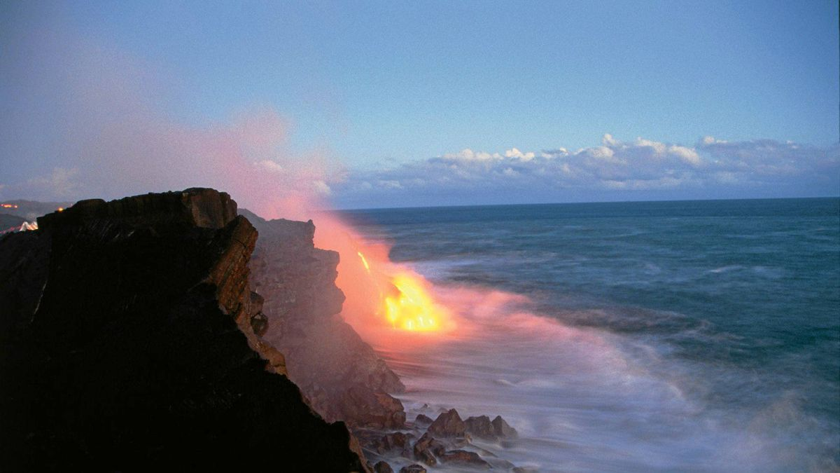 Lava from Kilauea Volcano meets the sea, Hawaii Island.