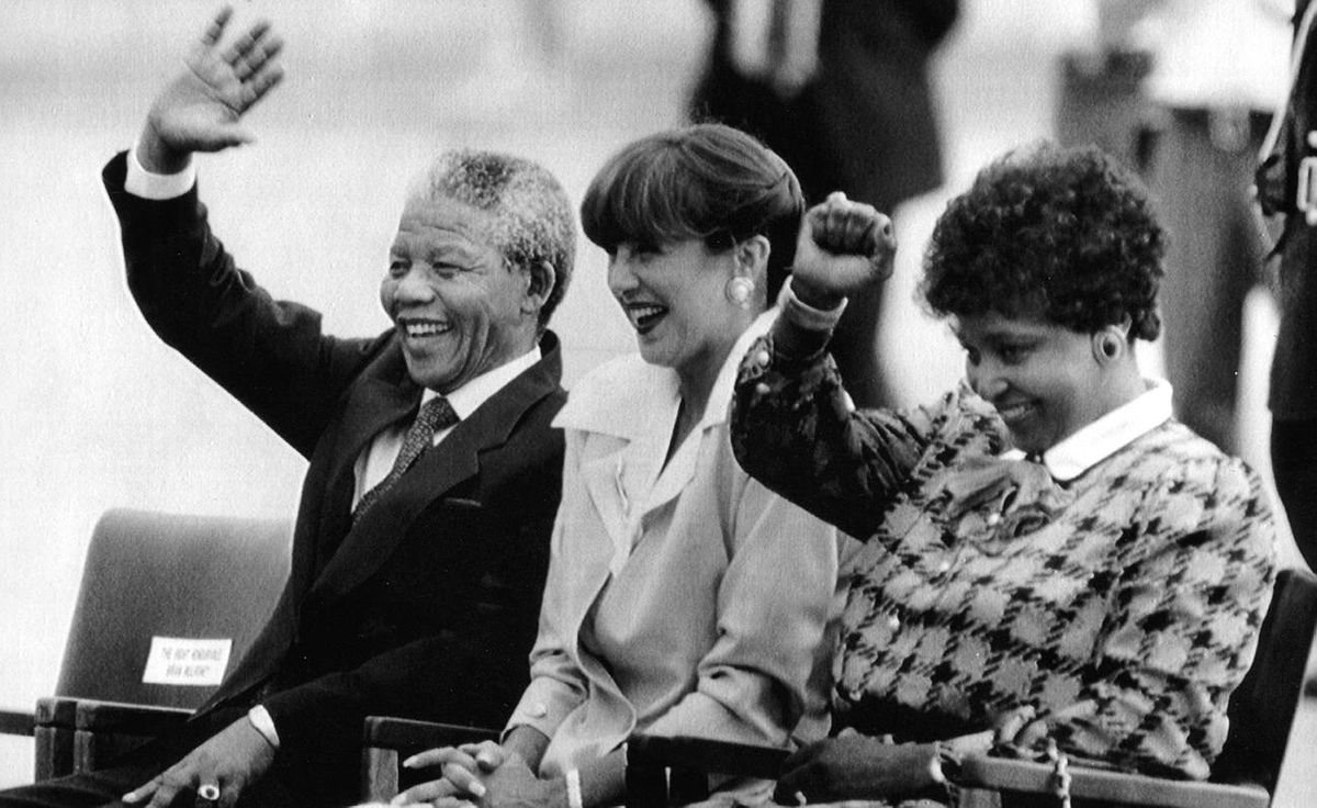 Mila Mulroney sits between Nelson Mandela and Winnie Mandela during arrival ceremonies in Ottawa June 17, 1990, at the start of the Mandelas' three-day Canadian visit.