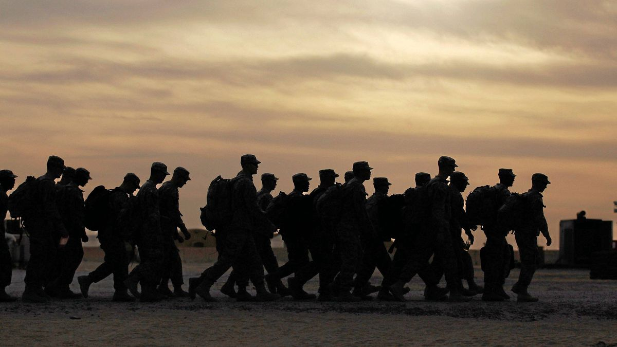 U.S. Army soldiers from the 2-82 Field Artillery, 3rd Brigade, 1st Cavalry Division walk to where they will board buses at Camp Virginia in Kuwait before flying home to Fort Hood, Tex. They were one of the last American combat units to leave Iraq on Thursday.