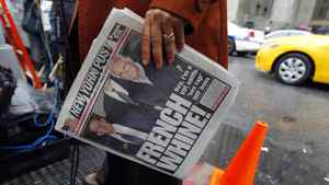 A television reporter holds a copy of the New York Post as she works outside Manhattan Criminal Court, where International Monetary Fund (IMF) chief Dominique Strauss-Kahn's arraignment is being held, in New York City May 16, 2011. Strauss-Kahn was denied bail on Monday on attempted rape and other criminal charges, and prosecutors said they are investigating whether he may have engaged in similar conduct once before.