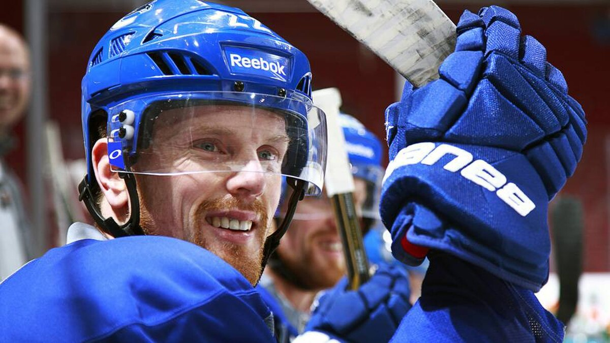 Daniel Sedin of the Vancouver Canucks looks on from the bench during practice at Rogers Arena in Vancouver, Canada April 9, 2012.