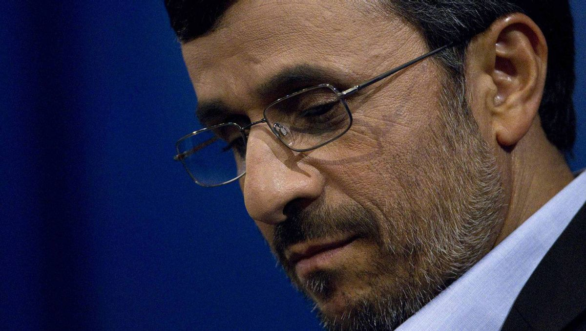 Iranian President Mahmoud Ahmadinejad checks his notes during a news conference in Tehran, June 7, 2011.