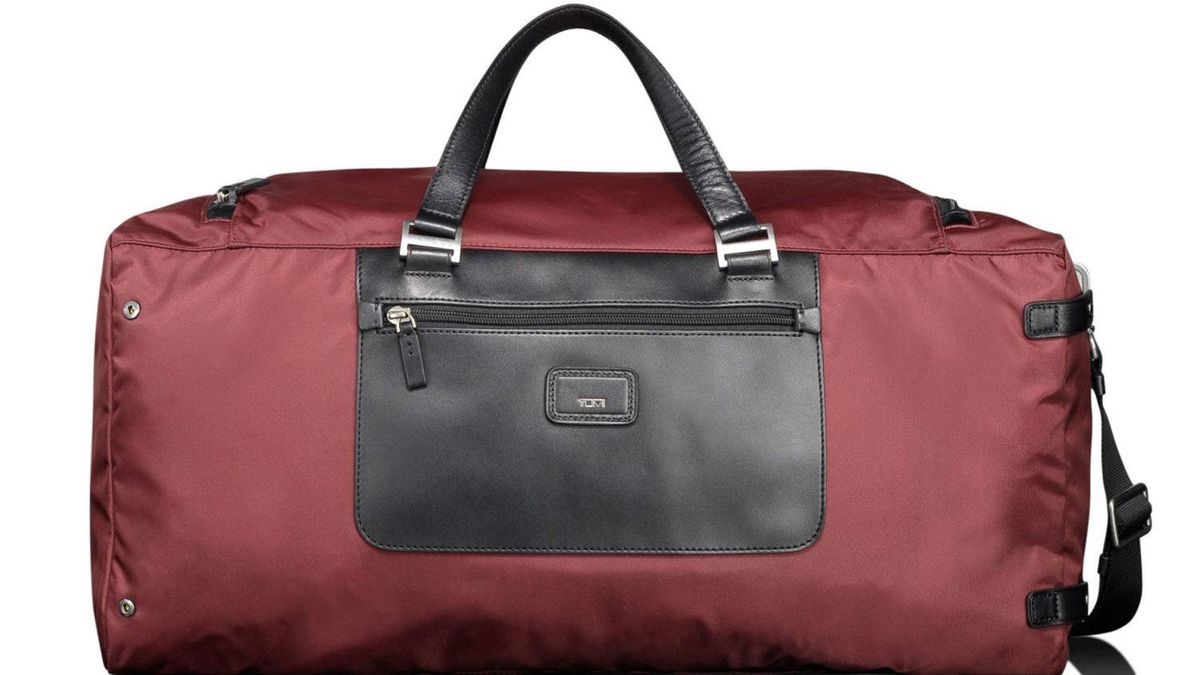 Stash with flash Carry Tumi's Pack-a-Way Duffle on your next weekend getaway. Made from lightweight nylon with leather pocket, straps and trim, this utilitarian satchel features a roomy main compartment and a front zippered pocket that is perfect for stashing your boarding pass and passport. Make use of the adjustable padded shoulder strap when your load gets heavy. $195; taschen.ca.