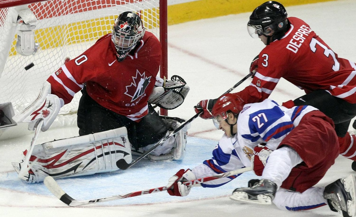 Team Russia forward Artemi Panarin (27) scores the game-winning goal on Team Canada goaltender Mark Visentin (30) as defenceman Simon Despres (3) defends during third period Gold medal game at the IIHF World Junior Hockey Championships in Buffalo, N.Y. on Wednesday January 5, 2011.