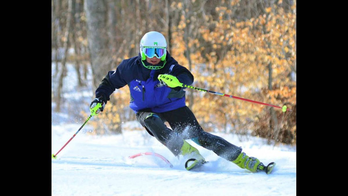15yr old Alexis Bernier of the Mont Ste Marie Alpine Racing Club gets some slalom training in during a warm sunny spring day.