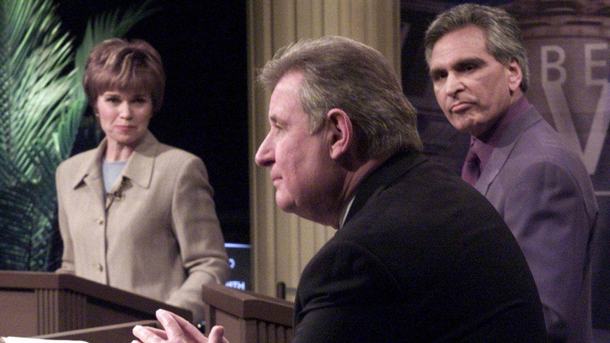 Mr. Klein speaks as New Democrat leader Raj Pannu and Liberal leader Nancy MacBeth look on during a election debate in Edmonton on February 26 2001.