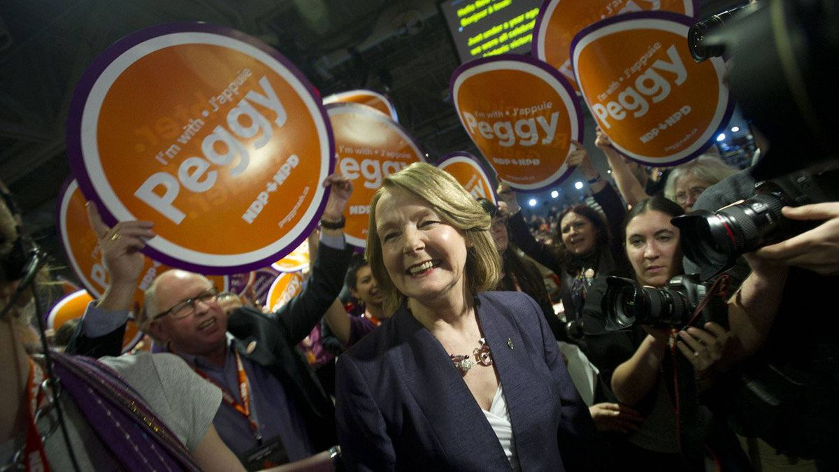 Candidate Peggy Nash makes her way through a sea of supporters at the NDP leadership convention at the Metro Toronto Convention Centre in Toronto, Ont. Friday, March 23, 2012.