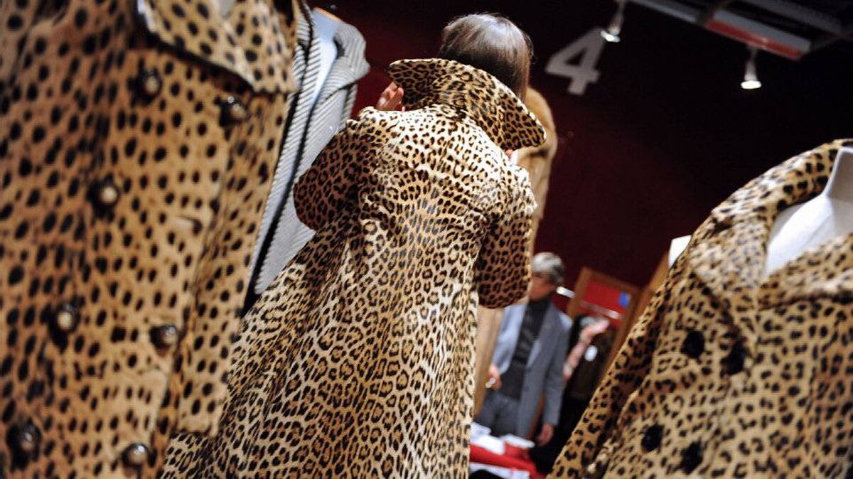 A woman tries a fur coat on October 25, 2008 at Hotel Drouot in Paris