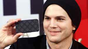 US actor Ashton Kutcher takes a photograph during a photo call on the occasion of a charity event in a shopping center in Pasching, near Linz, Austria, on Friday, Oct. 29, 2010.