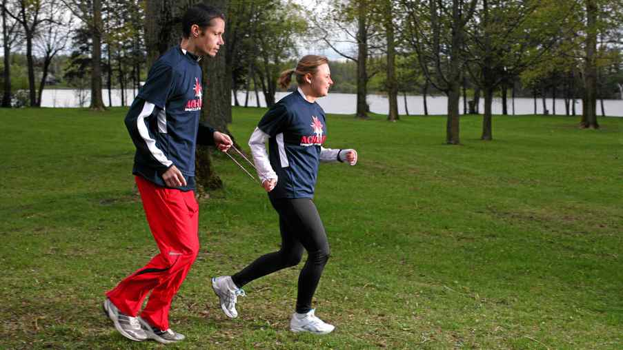 Achilles Ottawa running member Janson Dunkerley, left, and Margarita Gorbounova take part in a training session run in Ottawa. Ottawa Race Weekend has included a new category to help blind and visually impaired runners to participate in the 10k race. for The Globe and Mail