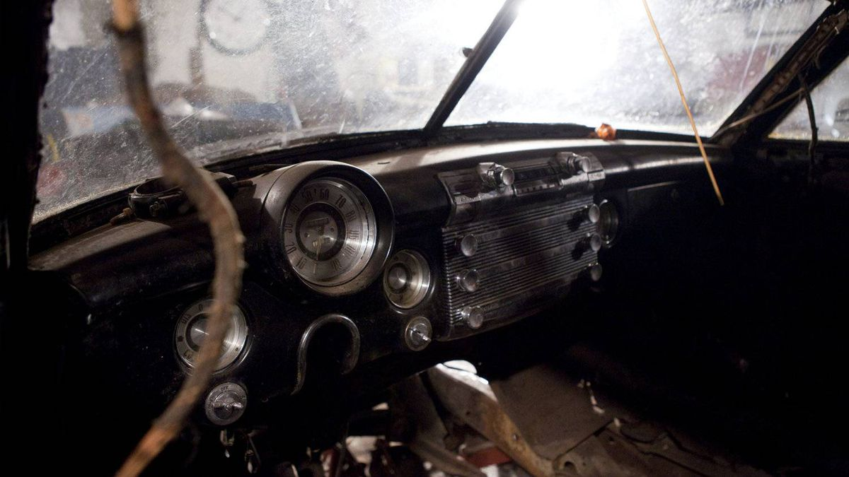 The inside dashboard of the car.