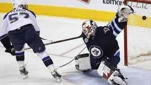 St. Louis Blues' David Perron (57) puts his penalty shot past Winnipeg Jets' goaltender Chris Mason (50) during the shot out to win their NHL game in Winnipeg on Saturday, February 25, 2012. THE CANADIAN PRESS/John Woods