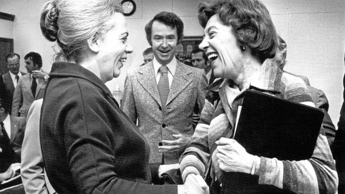 Jean Pigott, left, is greeted by MP Flora MacDonald as a newly elected Progressive Conservative MP in 1976. Joe Clark looks on.