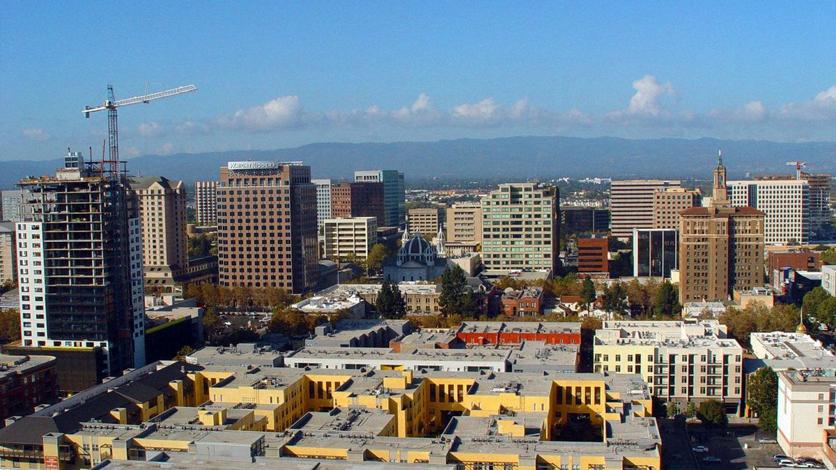 "Silicon Valley's capital city San Jose, California as seen in this aerial photo is undergoing an urban development revolution calculated to keep it as the thriving heart of a region renowned for technological innovation.The city is working to reverse a trend in which promising startups take root in suburbs and neighboring cities such as Mountain View, Sunnyvale, and Cupertino -- the homes of Google, Yahoo and Apple respectively. Districts brimming with high-density housing are now blossoming near downtown office towers. There are 32,000 units in or near the city center and ""enterprise incubation centers"" have sprung up to nurture start-ups in the areas of software, bioscience, environment and market access."