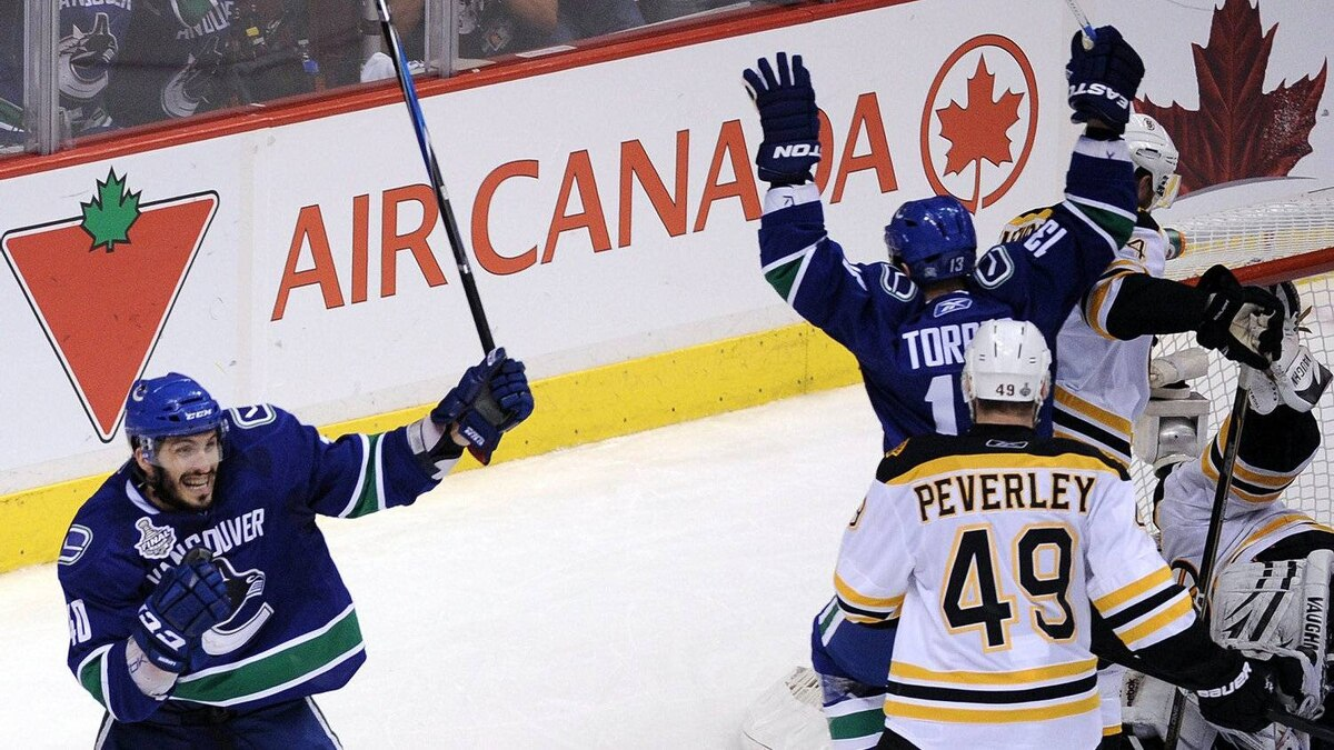 Maxim Lapierre of the Vancouver Canucks celebrates after scoring a goal in the third period against the Boston Bruins during Game 5 of the 2011 NHL Stanley Cup Final at Rogers Arena on June 10, 2011 in Vancouver.