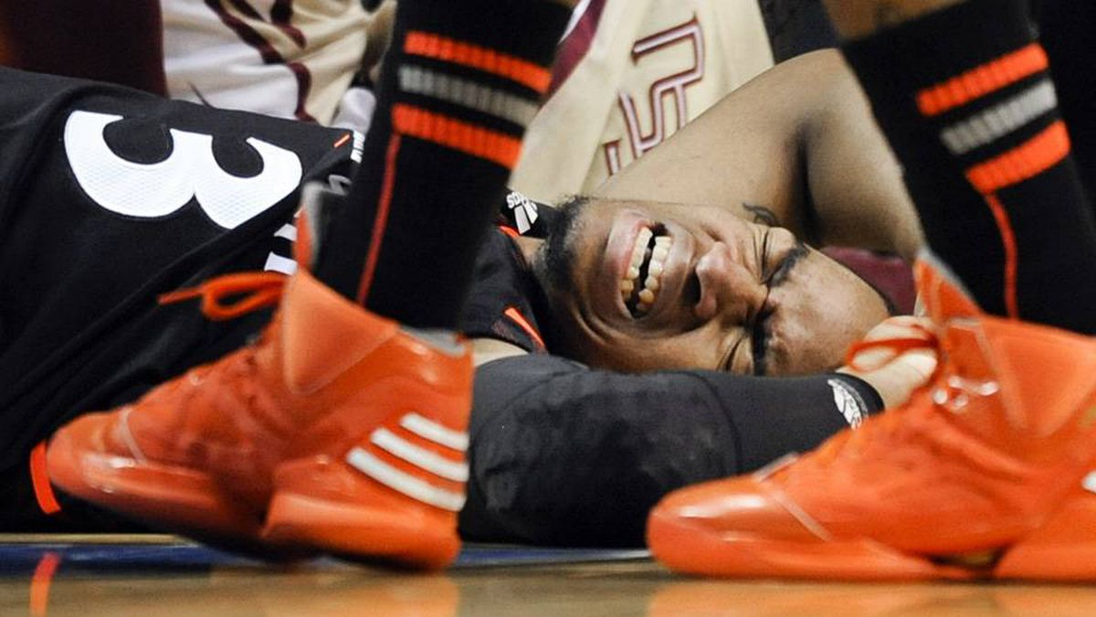 Cincinnati guard Dion Dixon lies on the court after being shaken up on a play in the second half of a third-round NCAA college basketball tournament game against Florida State.