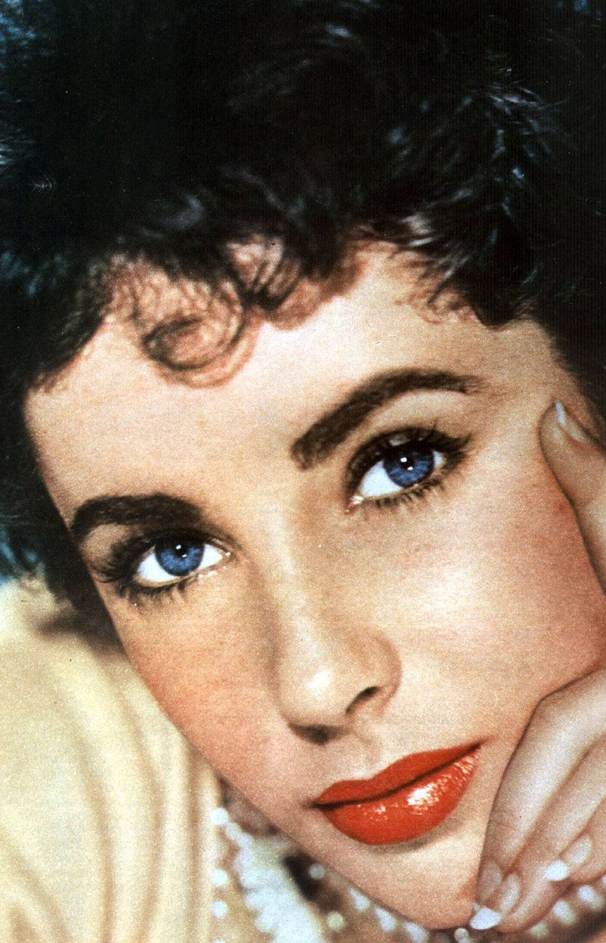 "Actress Elizabeth Taylor dies of heart failure at age 79 The violet-eyed film star was a mesmerizing screen presence who married well and often. Diamonds were among her friends, as was, of all people, Michael Jackson. ""That girl has true glamour,"" her two-time husband Richard Burton once said. ""If I retired tomorrow, I'd be forgotten in five years, but she would go on forever."""