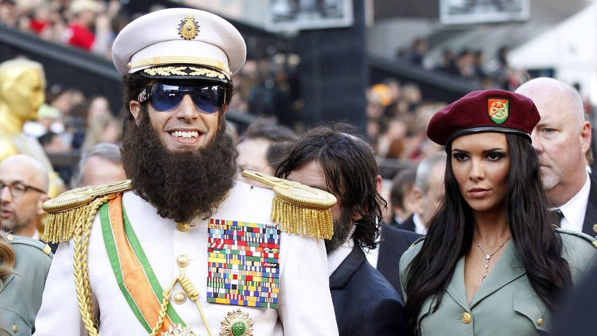 Sacha Baron Cohen, dressed in character from his new film The Dictator, arrives at the 84th Academy Awards in Hollywood, California Feb. 26, 2012.