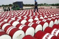 An Indonesian worker walks on barrels of oil at a distribution station of the state-owned oil company Pertamina in Jakarta, Indonesia, in this June 24, 2005 file photo.