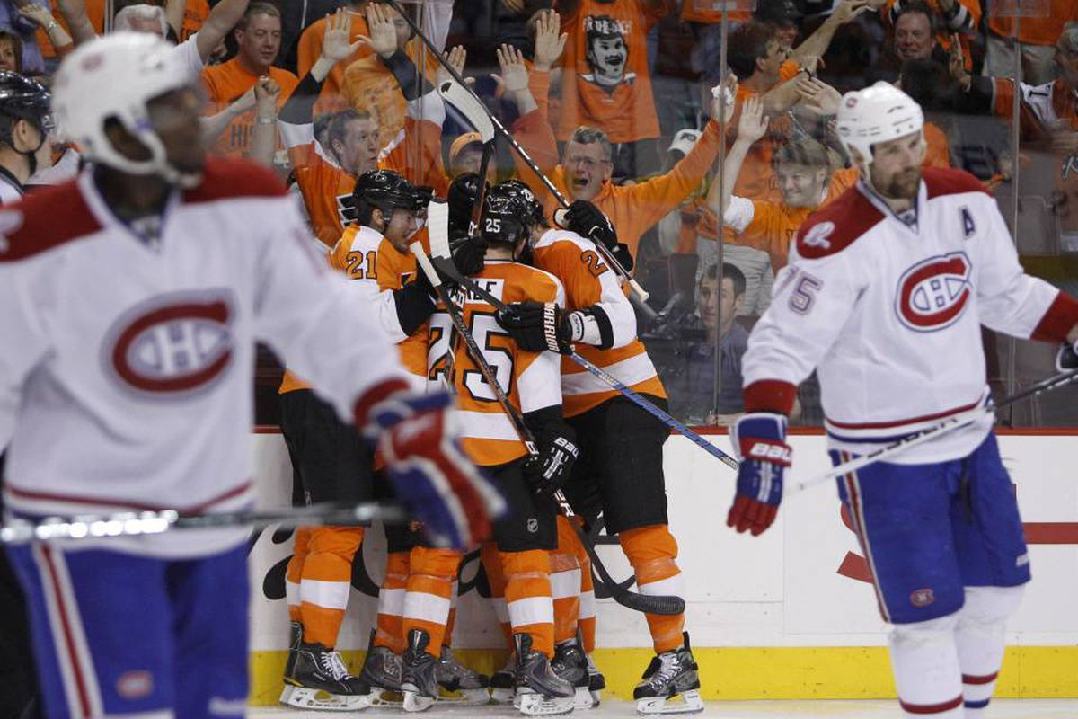 Philadelphia Flyers, center, celebrate a goal by Arron Asham as Montreal Canadiens' P.K. Subban, left, and Hal Gill skate by in the second period of Game 5 of the NHL hockey Eastern Conference finals, Monday, May 24, 2010, in Philadelphia.