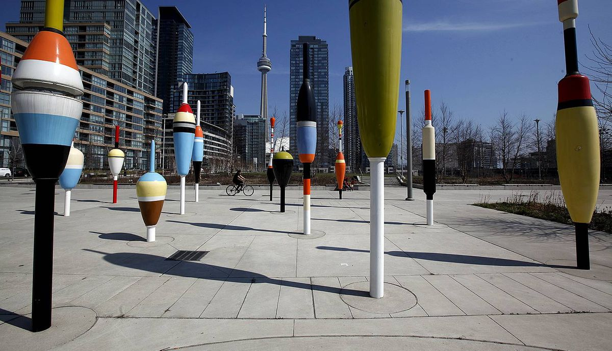 Various Bobber statues in Bobber Plaza in Toronto on March 22, 2012. Shapes can be played off the condominium buildings and also mimics the CN Tower in the skyline.