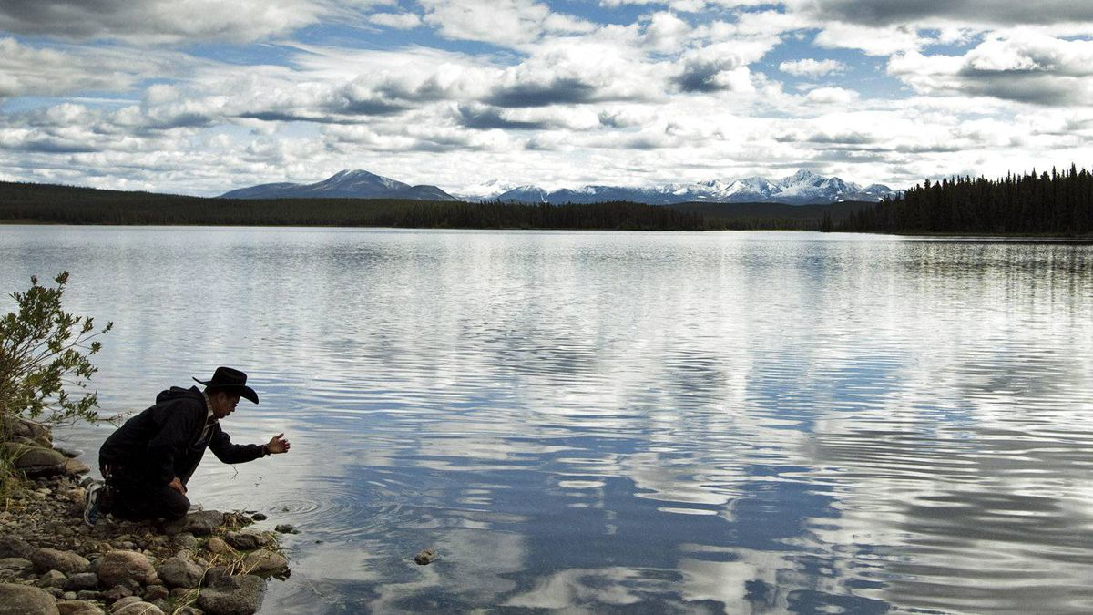 A member of Xeni Gwet'in First Nation stands at the edge of Fish Lake in British Columbia on Sept. 10, 2010.