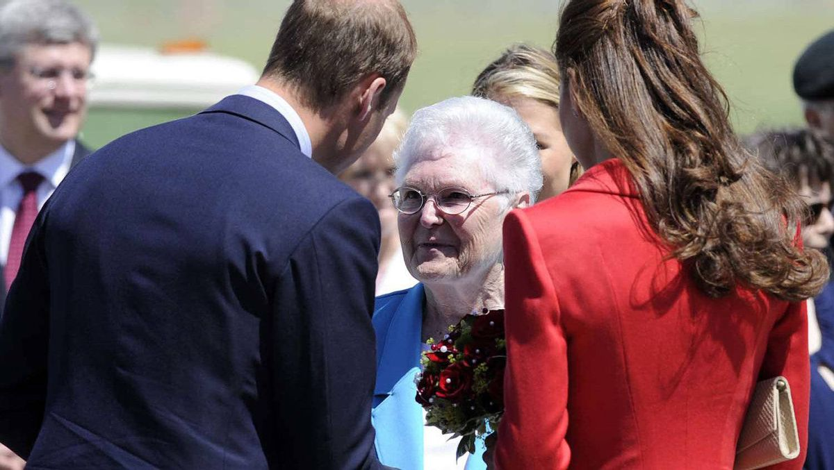 Prince William and his wife Catherine, Duchess of Cambridge, talk with Frances Miller (C) after she presented them with flowers at the airport in Calgary, Alberta, July 8, 2011.
