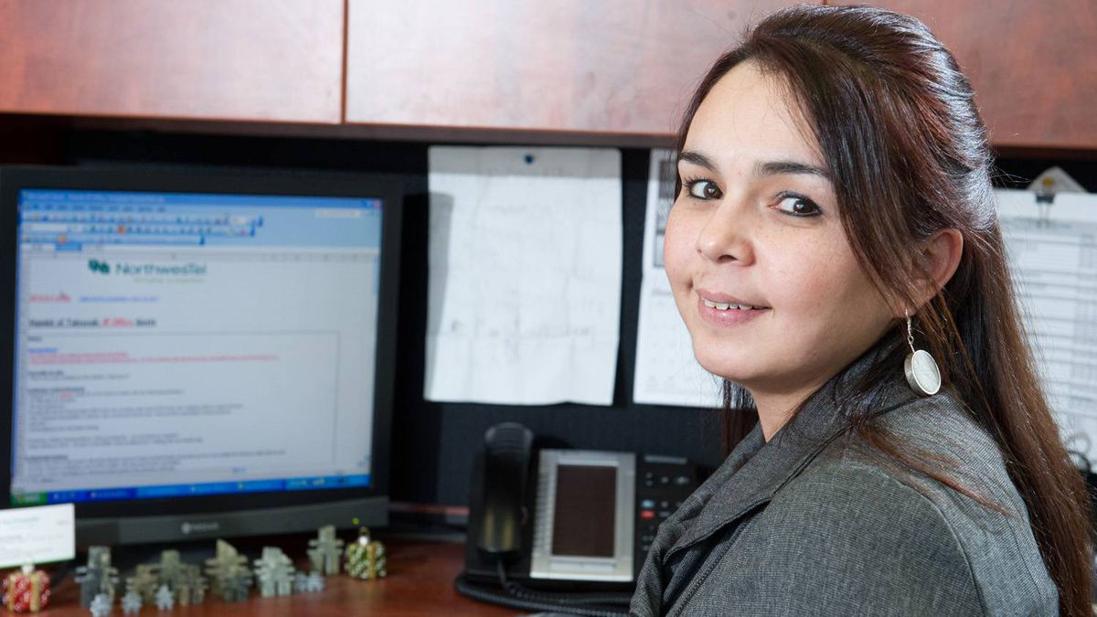 Carmen Kootoo, a sales account manager with Northwestel Inc., says landing a job with the firm more than 17 years ago allowed her to stay close to family in Iqaluit yet still develop her business skills