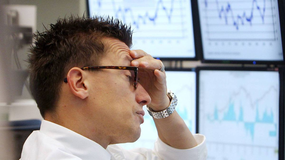 A trader watches his screens at the stock market in Frankfurt, Germany, Thursday, Sept. 22 2011, when the stock index DAX lost about four per cent.
