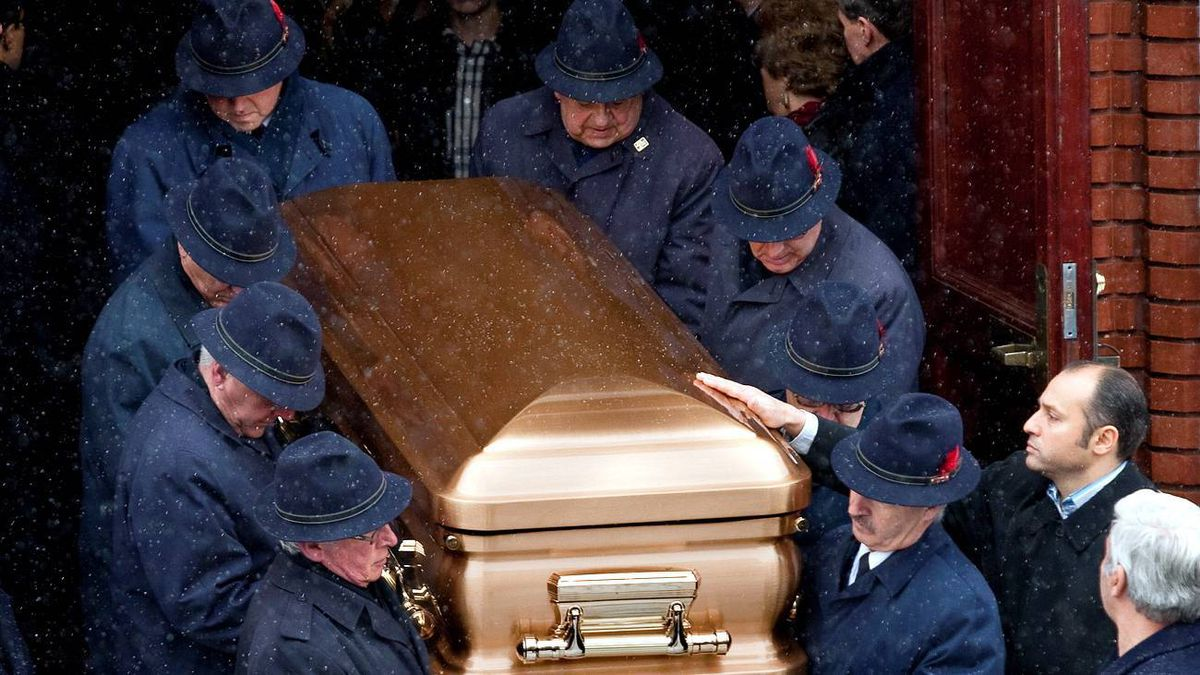 The casket bearing the remains of Nick Rizzuto is carried out of church following funeral services on Jan. 2, 2010, in Montreal.