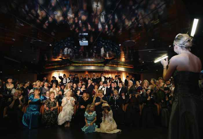 Passengers in period costume gather for a group picture on the Titanic Memorial Cruise on Saturday.