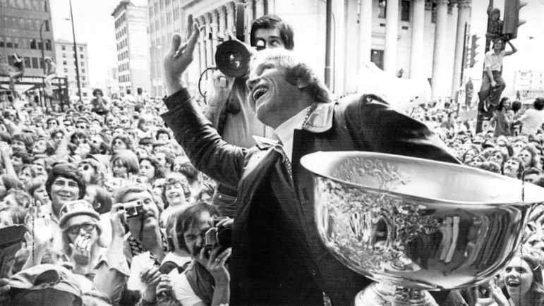 Bobby Hull of the Winnipeg Jets waves to well-wishers in a hotel window after a victory parade on May 28, 1976 in Winnipeg. Thousands lined an eight-block stretch along Portage Ave., in a tribute to the Jets, who defeated the defending champion Houston Aeros to capture the World Hockey Association championship in a four-game sweep.