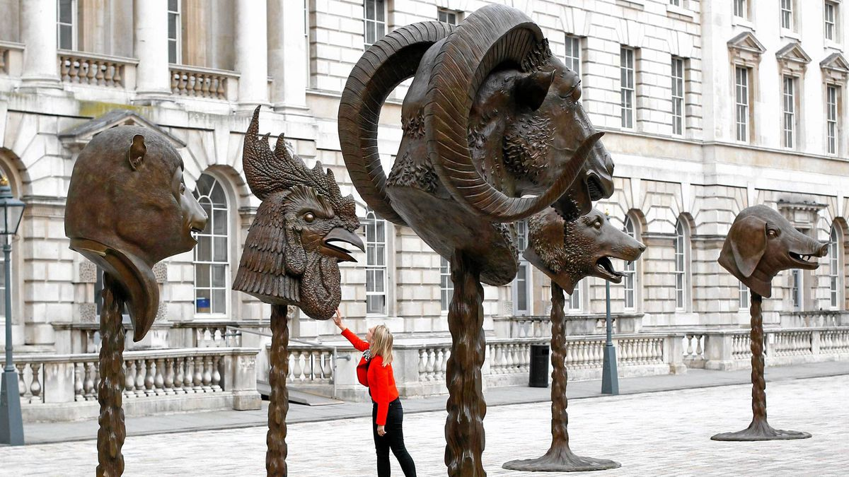 "A visitor looks at Ai Weiwei's ""Circle of Animals/Zodiac Heads"" at Somerset House in London May 11, 2011. The exhibition which comprises of 12 bronze animal heads recreated from traditional Zodiac sculptures, is on view from May 12 to June 26."