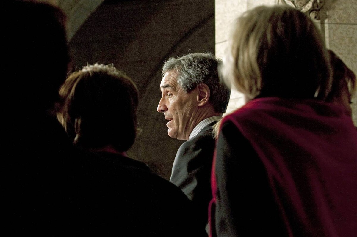 Surrounded by MPs, Liberal Leader Michael Ignatieff speaks with the parliamentary press on Tuesday, February 2, 2010.