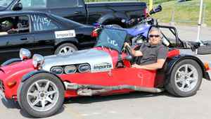 Peter Cheney in one of the world's great Woman-Repeller vehicles, a Lotus 7 replica. Hair-destroying aerodynamics, rough ride and an exhaust pipe that hangs off the side like a red-hot branding iron mean that your first date will probably be your last.