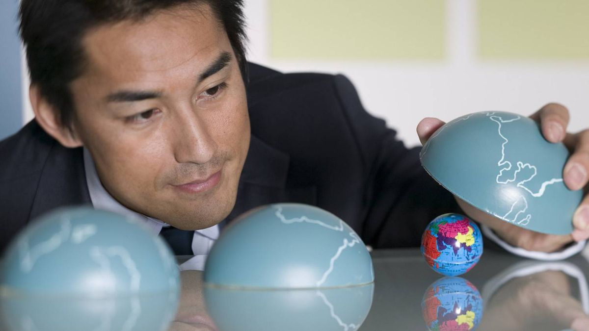 Businessman playing with globes